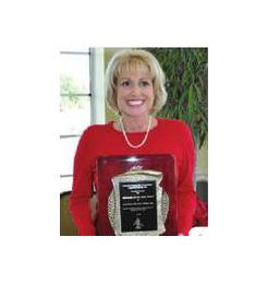 Ann Marie Gilden holding award